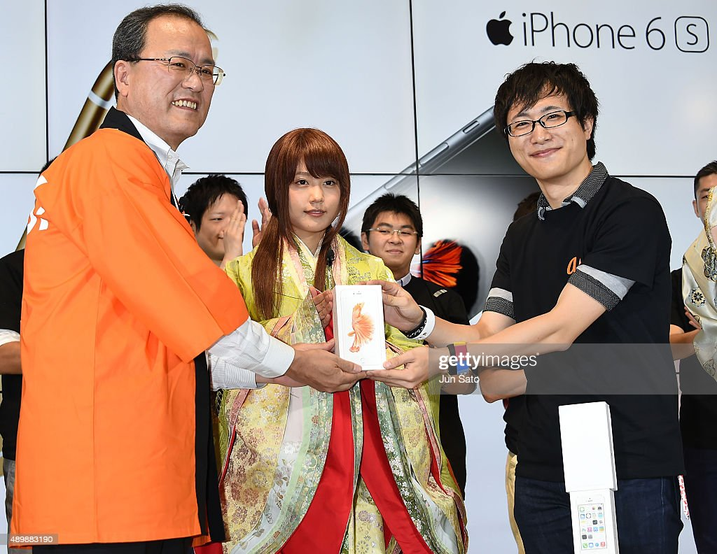 CEO of KDDI Takashi Tanaka and actress Kasumi Arimura and guest attend the news conference of launching iPhone 6s and 6s Plus at AU Shinjuku flagship...