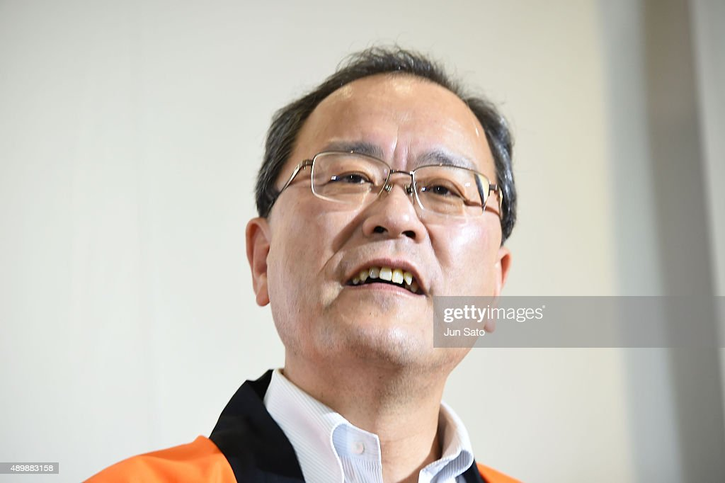 CEO of KDDI Takashi Tanaka attends the news conference of launching iPhone 6s and 6s Plus at AU Shinjuku flagship store on September 25 2015 in Tokyo...