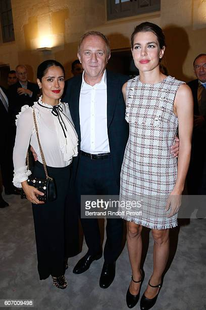 CEO of Kering Group FrancoisHenri Pinault standing between his wife actress Salma Hayek and Charlotte Casiraghi attend the 4O Rue de Sevres Preview...