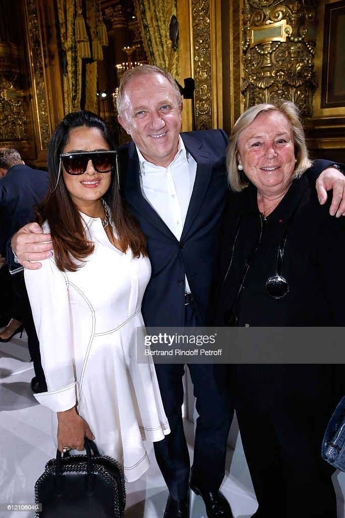CEO of Kering Group, Francois-Henri Pinault standing between his wife Salma Hayek (L) and his mother Maryvonne Pinault attend the Stella McCartney show as part of the Paris Fashion Week Womenswear Spring/Summer 2017 on October 3, 2016 in Paris, France.