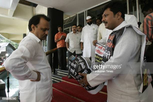 MLA of Kolhapur Rajesh Kshirsagar shows quality of drinking water supplied to Kolhapur city to Ajit Pawar and demand better water supplied from...