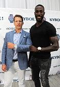 CFO of KYBOE Joe Roos and Tony Thomas Sports pose at the KYBOE Watches Miami Swim Week fashion show on July 15 2016 in Miami Beach Florida