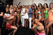 CFO of KYBOE Joe Roos Jenn Taule Bell and CEO of KYBOE Marc Bell pose with models backstage at the KYBOE Watches Miami Swim Week fashion show on July...