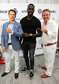 CFO of KYBOE Joe Roos Tony Thomas Sports and CEO of KYBOE Marc Bell pose at the KYBOE Watches Miami Swim Week fashion show on July 15 2016 in Miami...