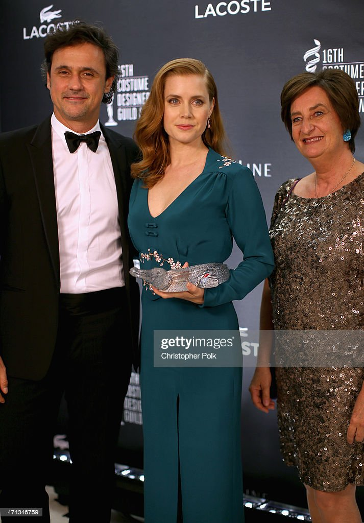 CEO of Lacoste North America Francis Pierrel, LACOSTE Spotlight Award Honoree Amy Adams, and Boardmember at Lacoste Beryl Lacoste-Hamilton attend the 16th Costume Designers Guild Awards with presenting sponsor Lacoste at The Beverly Hilton Hotel on February 22, 2014 in Beverly Hills, California.