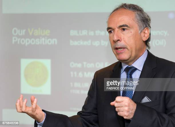 CEO of London company R Fintech Plc Ignacio Ozcariz gestures as he speaks during the launching of the Bilur a cryptocurrency aiming to compete with...