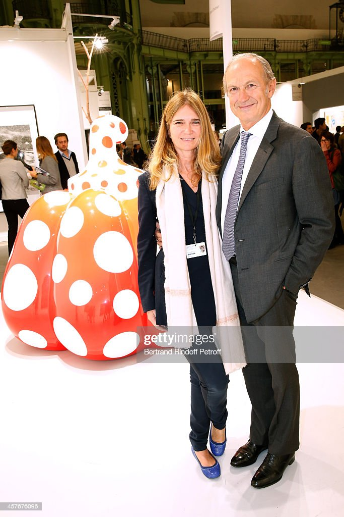 CEO of L'Oreal <a gi-track='captionPersonalityLinkClicked' href=/galleries/search?phrase=Jean-Paul+Agon&family=editorial&specificpeople=675160 ng-click='$event.stopPropagation()'>Jean-Paul Agon</a> with his Companion galerist Sophie Scheidecker attend the FIAC 2014 - International Contemporary Art Fair - : Official Opening at Le Grand Palais on October 22, 2014 in Paris, France.