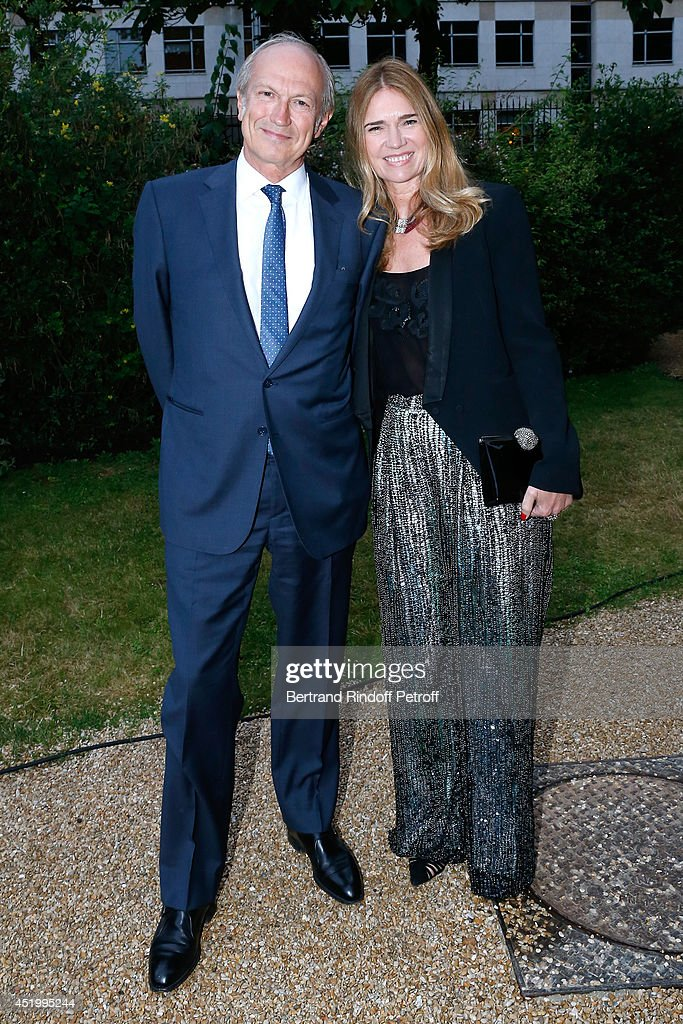 CEO of L'Oreal <a gi-track='captionPersonalityLinkClicked' href=/galleries/search?phrase=Jean-Paul+Agon&family=editorial&specificpeople=675160 ng-click='$event.stopPropagation()'>Jean-Paul Agon</a> with his Companion Sophie Scheidecker attend the 'Chambre Syndicale de la Haute Couture' Cocktail, to celebrate the end of the Paris Fashion Week. Held at Hotel Salomon de Rothschild on July 10, 2014 in Paris, France.