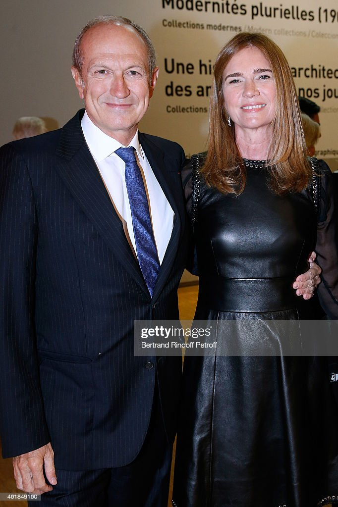 CEO of L'Oreal <a gi-track='captionPersonalityLinkClicked' href=/galleries/search?phrase=Jean-Paul+Agon&family=editorial&specificpeople=675160 ng-click='$event.stopPropagation()'>Jean-Paul Agon</a> with his Companion Sophie Scheidecker attend the 'Societe des Amis du Musee National d'Art Moderne' : Dinner at Beaubourg on January 20, 2015 in Paris, France.