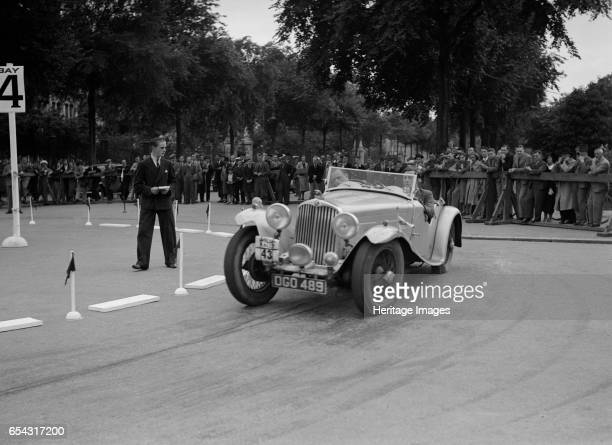 AC of LP Jaques competing in the South Wales Auto Club Welsh Rally 1937 Artist Bill Brunell AC 1936 1991 cc Vehicle Reg No DGO489 Event Entry No 43...