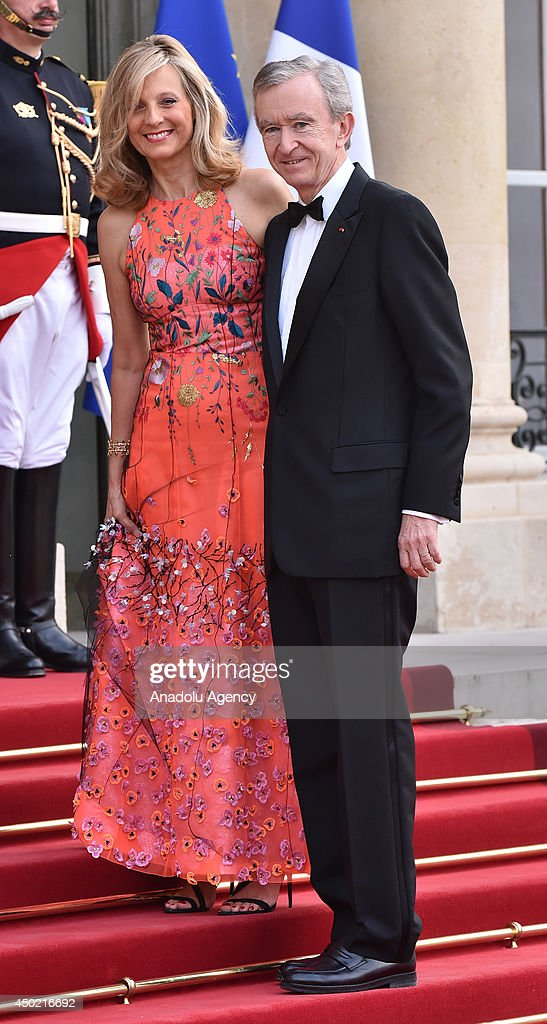 CEO of LVMH Bernard Arnault (R) and his wife Helene Arnault arrive to Elysee Palace for the State dinner in honor of the Queen hosted by French President Francois Hollande in Paris, France on 6 June, 2014.