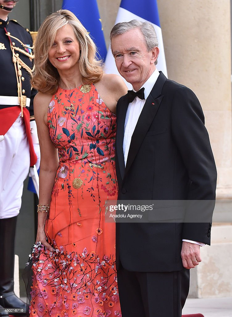 CEO of LVMH Bernard Arnault (R) and his wife Helene Arnault arrive to Elysee Palace for the State dinner in honor of the Queen hosted by French President Francois Hollande in Paris, France. June 6 2014.