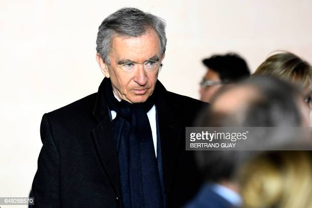CEO of LVMH Bernard Arnault arrives to attend the Louis Vuitton women's FallWinter readytowear collection fashion show in Paris on March 7 2017 / AFP...