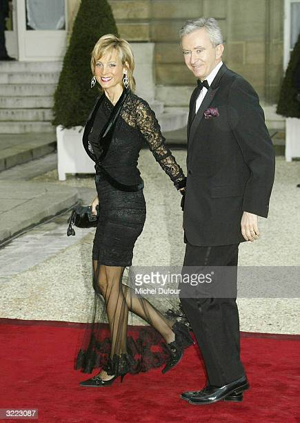 CEO of LVMH Bernard Arnault arrives with his wife pianist Helene Mercier at the Elysee Palace for a state banquet hosted by French President Jacques...