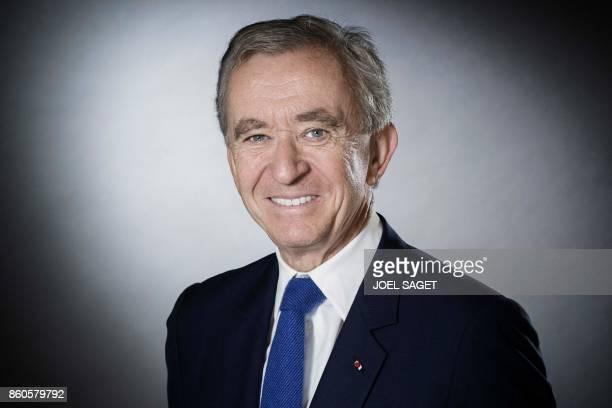 CEO of LVMH Bernard Arnault poses during a photo session in Paris on September 19 2017 / AFP PHOTO / JOEL SAGET