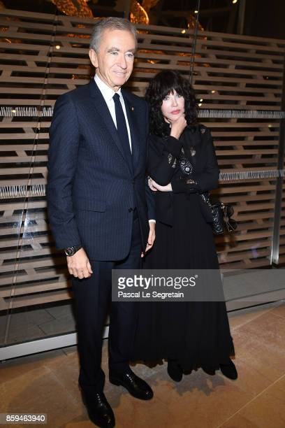 O of LVMH Group Bernard Arnault and Isabelle Adjani attend 'Etre Moderne Le MoMA A Paris' Exhibition at Fondation Louis Vuitton on October 9 2017 in...