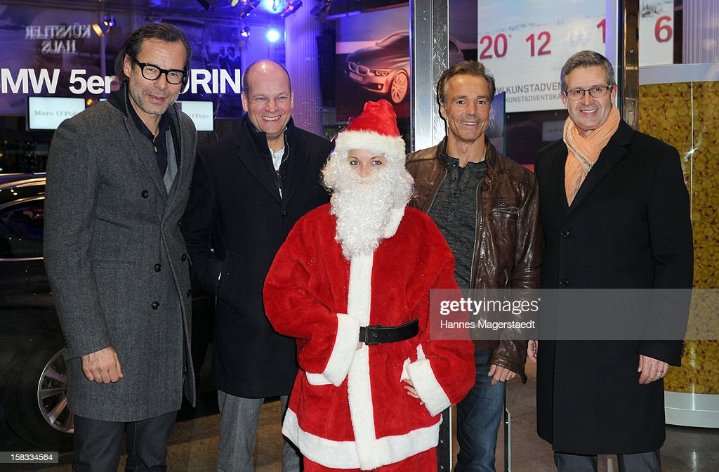 CEO of Marco Polo Andreas Baumgaertner, Alexander Gedat, Hannes Jaenicke and Director Marketing Germany of BMW Johannes Seibert attend the BMW Adventskalender opening with Hannes Jaenicke at the BMW Pavillion on December 13, 2012 in Munich, Germany.