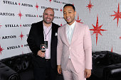 VP of Marketing High End Imports at AnheuserBusch InBev Ricardo Marques and John Legend attend the unveiling of 'Stars' by Stella Artois where John...