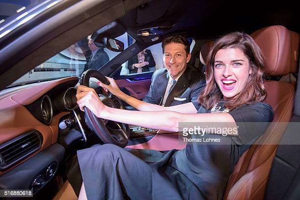 CEO of Maserati Europa Giulio Pastore and Marie Nasemann pictured inside the new Maserati Levante at 'Klassikstadt' on March 21 2016 in Frankfurt am...