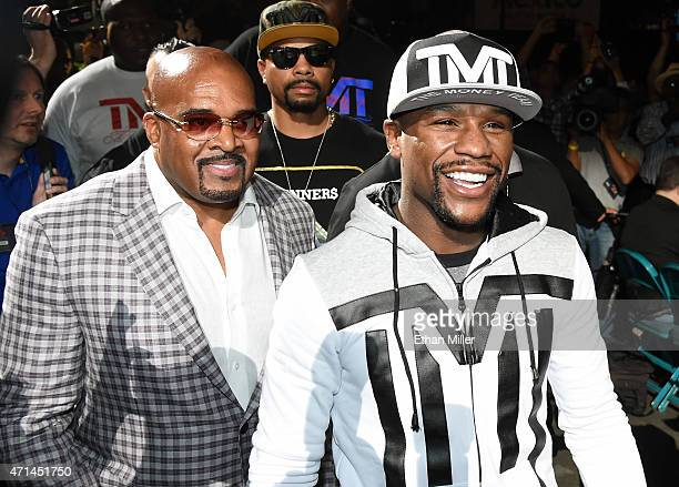 CEO of Mayweather Promotions Leonard Ellerbe and WBC/WBA welterweight champion Floyd Mayweather Jr arrive at MGM Grand Garden Arena on April 28 2015...