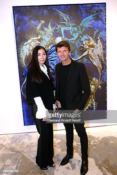 CEO of Mazarine Group and Founder of 'Studio des Acacias' PaulEmmanuel Reiffers and his wife Margaux dressed in Chloe attend the 'New American Art'...