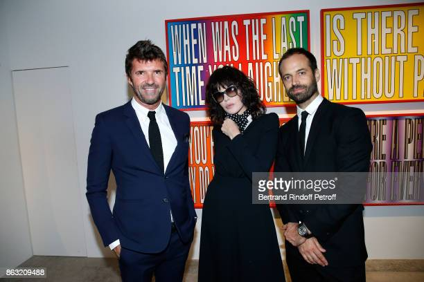 CEO of Mazarine Group PaulEmmanuel Reiffers Isabelle Adjani and Benjamin Millepied attend the Art Exhibition Reflexion Redux of Benjamin Millepied...