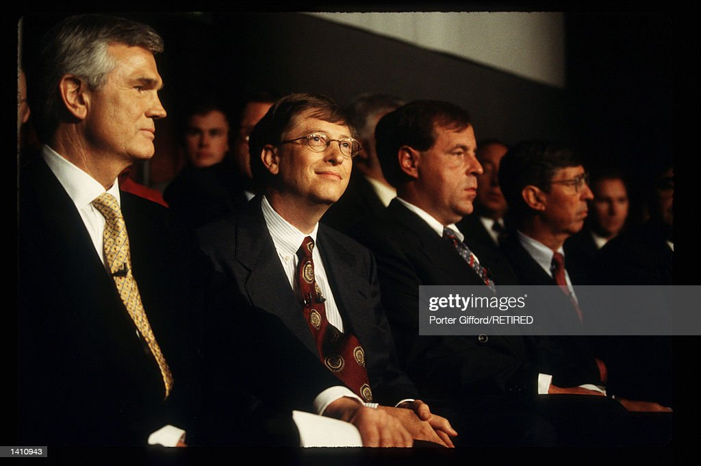 CEO of Microsoft Bill Gates Eckhard Pfeiffer of Compaq and James Halpin of Comp USA attend an Antitrust press conference May 5 1998 in New York City...