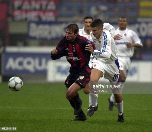 LEONARDO of Milan and Alessandro GAMBERINI of BOLOGNA in action during the SERIE A 19th Round League match between Milan and Bologna played at the...
