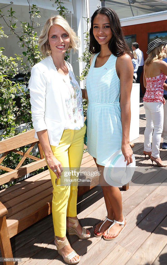 CEO of Miss France Company <a gi-track='captionPersonalityLinkClicked' href=/galleries/search?phrase=Sylvie+Tellier&family=editorial&specificpeople=2293780 ng-click='$event.stopPropagation()'>Sylvie Tellier</a> and Miss France 2014 <a gi-track='captionPersonalityLinkClicked' href=/galleries/search?phrase=Flora+Coquerel&family=editorial&specificpeople=11782455 ng-click='$event.stopPropagation()'>Flora Coquerel</a> attend the Men's Final of Roland Garros French Tennis Open 2014 - Day 15 on June 8, 2014 in Paris, France.