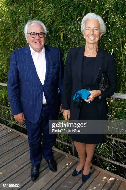CEO of 'Moet Hennessy' Christophe Navarre and IMF Managing Director Christine Lagarde attend the 2017 French Tennis Open Day Thirteen at Roland...