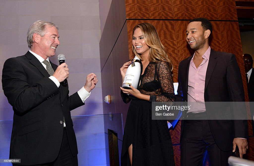 CEO of Moet Hennessy USA Jim Clerkin, model Chrissy Teigen and singer-songwriter John Legend attend DuJour Magazine and NYY Steak celebrating Chrissy Teigen with FENDI timepieces and Moet Ice on July 28, 2014 in New York City.