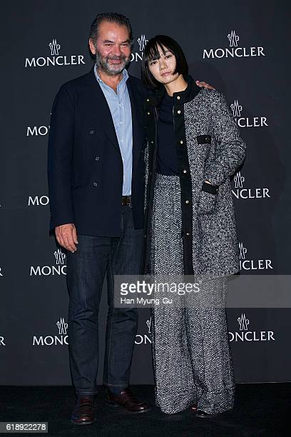 CEO of Moncler Remo Ruffini and South Korean actress Bae DooNa attend the photocall for 'MONCLER' flagship store opening on October 28 2016 in Seoul...