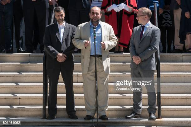 CEO of Muslim Welfare House Toufik Kacimi speaks as he is flanked by Chairman of Finsbury Park Mosque Mohammed Kozbar and Leader of Islington Council...