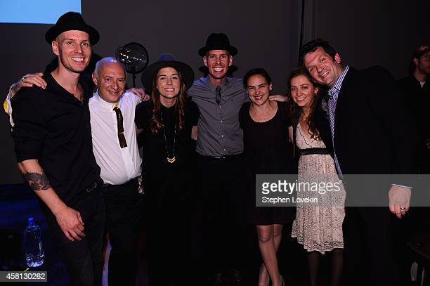 CEO of Mylio Development LLC David Vaskevitch musician Brandi Carlile and guests pose at Popular Photography's celebration of the lauch of Mylio on...