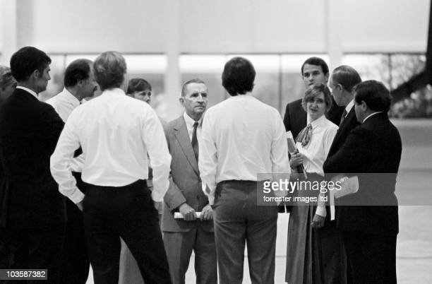 CEO of NeXT Steve Jobs and the NeXT Board of Directors have a meeting in the unfinished factory in Fremont CA in June 1987 Investor Ross Perot stands...