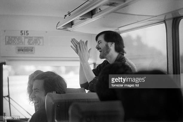 CEO of NeXt Steve Jobs with NeXT employees on the bus after a visit to the unfinished factoy in Fremont CA in March 1987