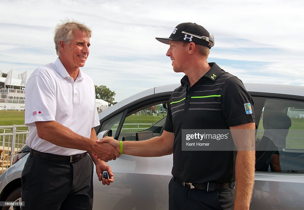 BMW of North America Executive Vice President Peter Miles hands over the keys to the to the all-new BMW i3 to PGA TOUR pro <a gi-track='captionPersonalityLinkClicked' href=/galleries/search?phrase=Hunter+Mahan&family=editorial&specificpeople=885292 ng-click='$event.stopPropagation()'>Hunter Mahan</a> at the 2013 BMW Championship on September 14, 2013 in Lake Forest, Illinois. Mahan was awarded the BMW i3 because he hit a hole-in-one on Conway Farm's 17th hole. The BMW i3 is the first purpose-built electric vehicle to be made primarily of carbon fiber from the ground up.
