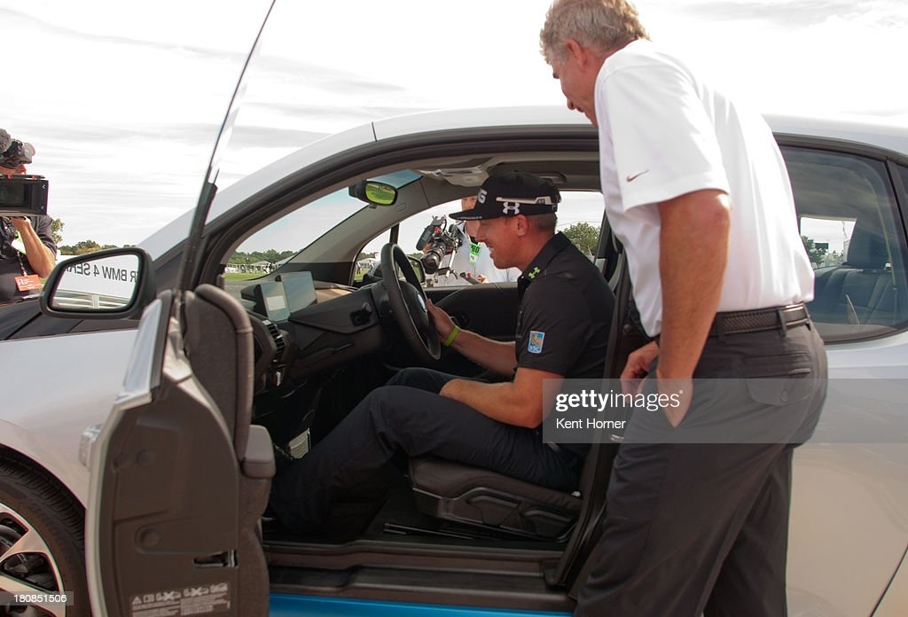 BMW of North America Executive Vice President Peter Miles shows PGA TOUR pro <a gi-track='captionPersonalityLinkClicked' href=/galleries/search?phrase=Hunter+Mahan&family=editorial&specificpeople=885292 ng-click='$event.stopPropagation()'>Hunter Mahan</a> the all-new BMW i3 that he just won at the 2013 BMW Championship on September 14, 2013 in Lake Forest, Illinois. Mahan was awarded the BMW i3 because he hit a hole-in-one on Conway Farm's 17th hole. The BMW i3 is the first purpose-built electric vehicle to be made primarily of carbon fiber from the ground up.