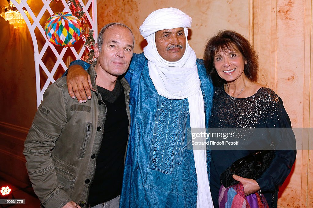 CEO of O.N.G. 'Tidene' Mohamed Ixa standing between Humorist Laurent Baffie (L) and Stephanie Fugain (R) attend 'Les Puits du Desert' Charity Gala at Cercle des Armees on November 19, 2013 in Paris, France.
