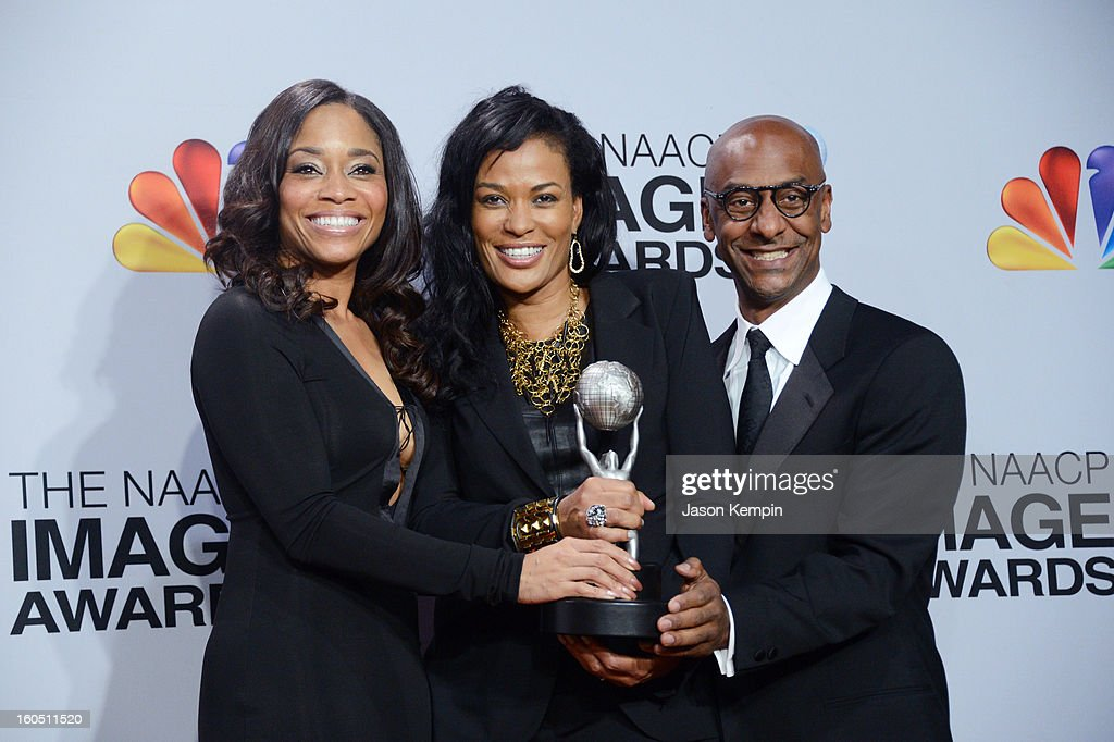 VP of Original Programming Connie Orlando (L) and BET President of Music Programming and Specials Stephen G. Hill (R) pose with Producer Beverly Bond (C), winner of the Variety Series or Special for 'Black Girls Rock' in the press room during the 44th NAACP Image Awards at The Shrine Auditorium on February 1, 2013 in Los Angeles, California.