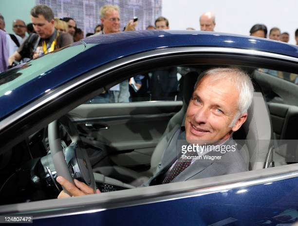 CEO of Porsche AG Matthias Mueller smiles during the press days at the IAA Frankfurt Auto Show on September 13 2011 in Frankfurt am Main Germany The...