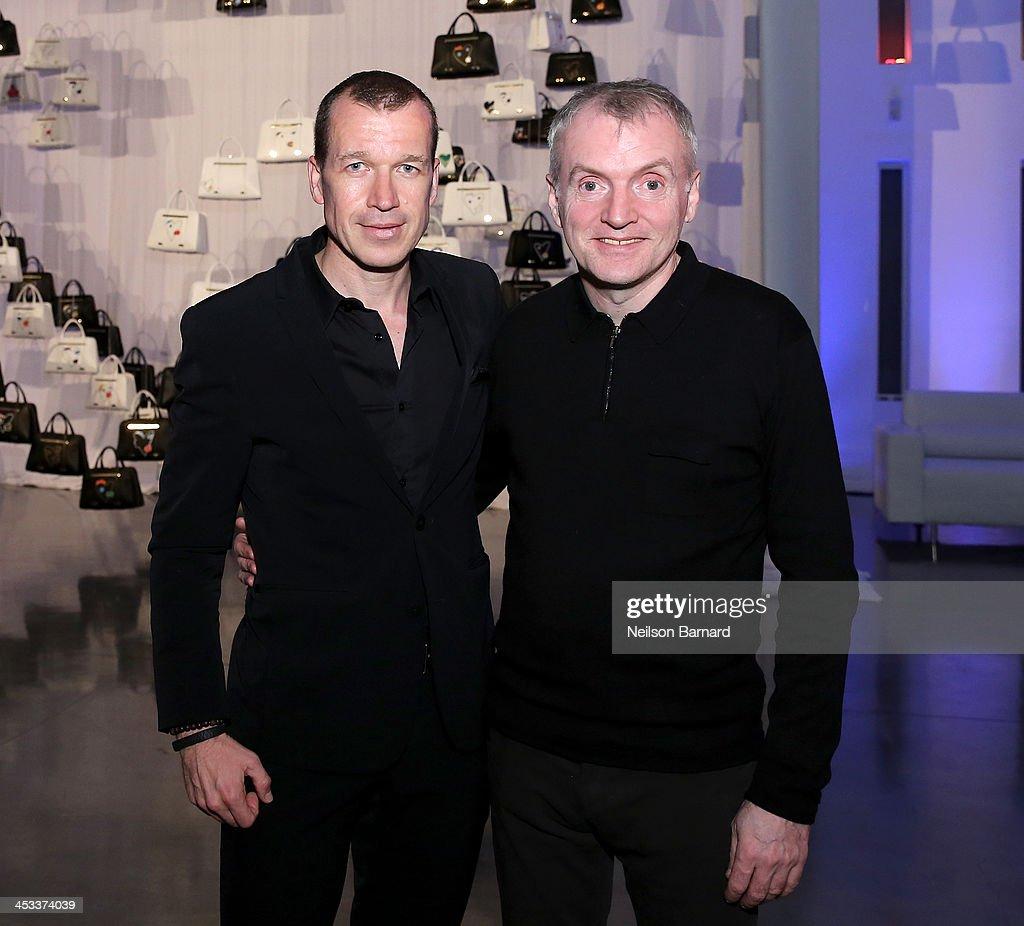 CEO of Porsche Design Group Juergen Gessler and Artist Thierry Noir attend the Porsche Design x Thierry Noir Art Basel Miami Beach Event at The...