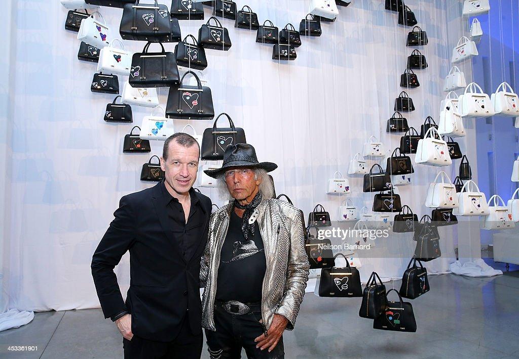 CEO of Porsche Design Group Juergen Gessler and James Goldstein attend the Porsche Design x Thierry Noir Art Basel Miami Beach Event at The Temple...