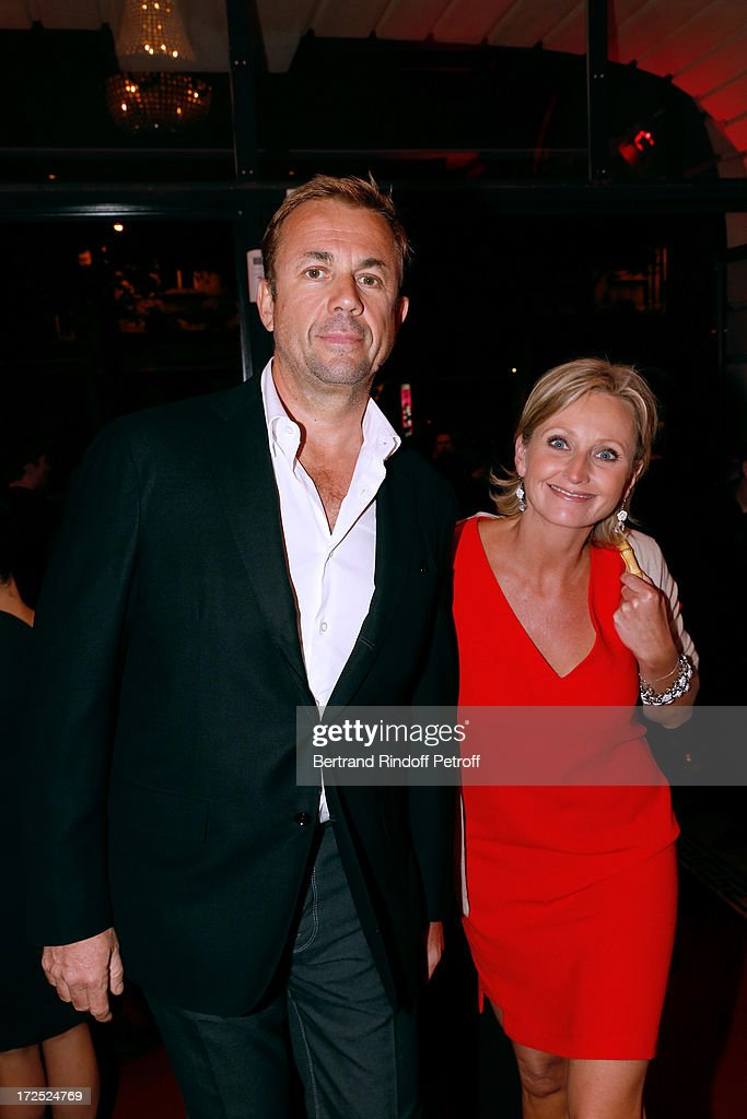 CEO of Prada Nathalie Bader (R) and Frederic attend 'Lancome show by Alber Elbaz' Party at Le Trianon on July 2, 2013 in Paris, France.
