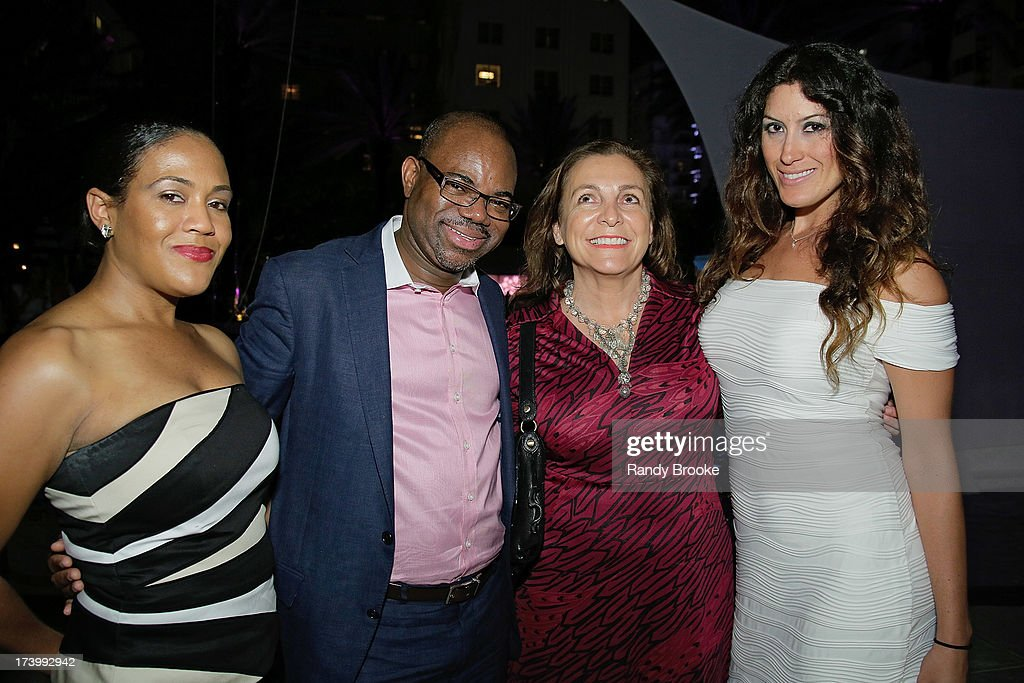 CEO of Reel Code Media Alexia Jones, Founder of Reel Code Media Isaac Daniel, friend Sylvia and Karla Bersano pose for Reel Code Media at Mercedes-Benz Fashion Week Swim 2014 - Kick Off Party at Raleigh Hotel on July 18, 2013 in Miami Beach, Florida.