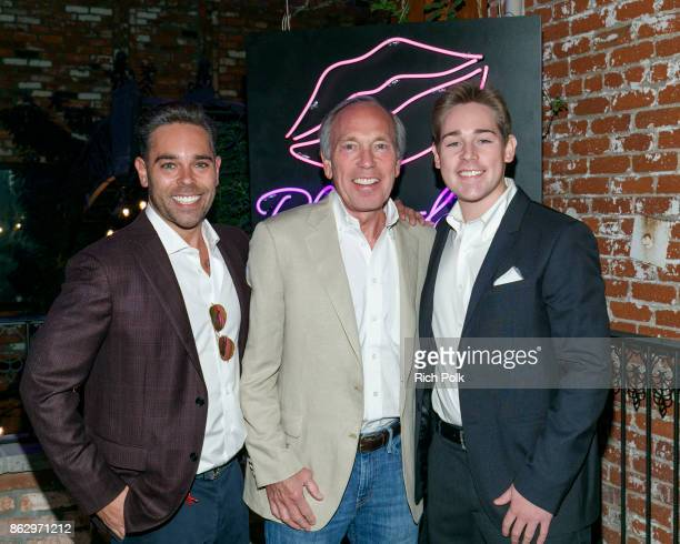 CEO of Rhonda's Kiss Charity Kyle Stefanski Chairman of Rhonda's Kiss Charity Marc A Stefanski and Alex Stefaski attend An Evening With Rhonda's Kiss...