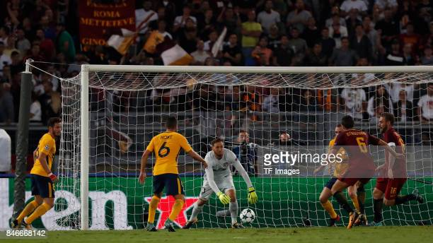 of Rom Jan Oblak of Atletico Madrid Koke Resurreccion of Atletico Madrid battle for the ball during the UEFA Champions League group C match between...