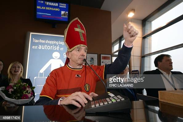 CEO of Ryanair Michael O'Leary dressed as SaintNicolas gestures as he announces the 40000th passenger of the flight to Milan during a press...