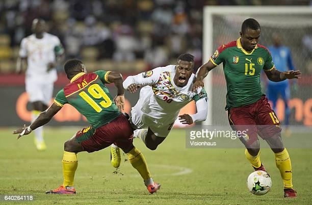 BALDÉ of Senegal and FAI COLLINS NGORAN SUIRI and SÉBASTIEN CLOVIS SIANI of Cameroon during the quarterfinal match between Senegal and Cameroon at...