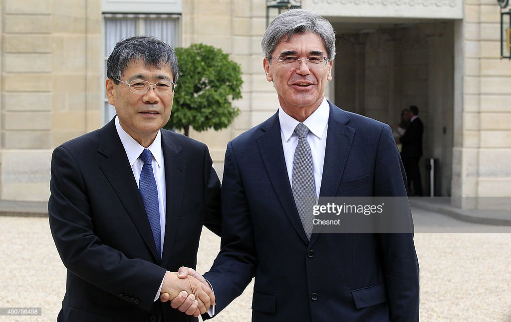 CEO of Siemens AG Joe Kaeser shakes hands with CEO of Mitsubishi Heavy Industries Shunichi Miyanaga after their meeting with French President...